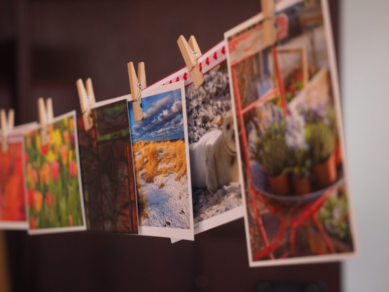 postcards hanging up on clothesline | direct mail