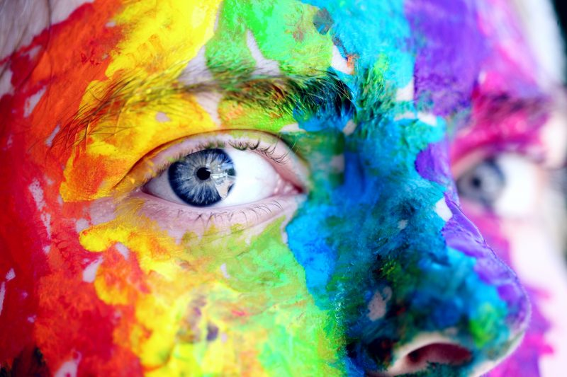face covered in bright paint colors | content that stands out