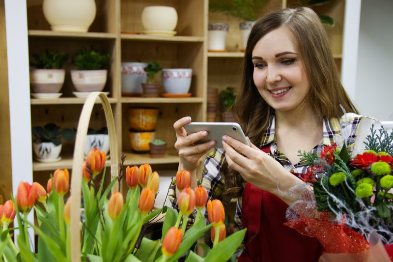 woman photographing flowers | marketing strategy rocks