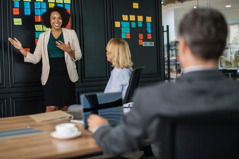 woman giving a presentation | sales presentation