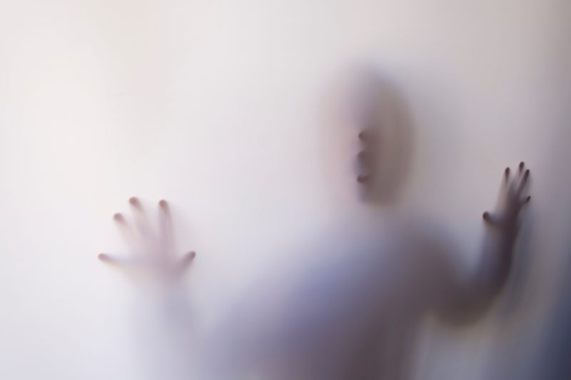 person behind frosted window | marketing companies ghost you