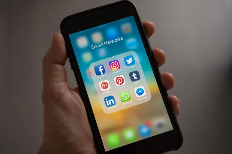 checking social media on smartphone | social media updates