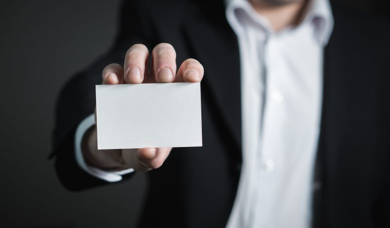 man holding a blank business card | bad business cards