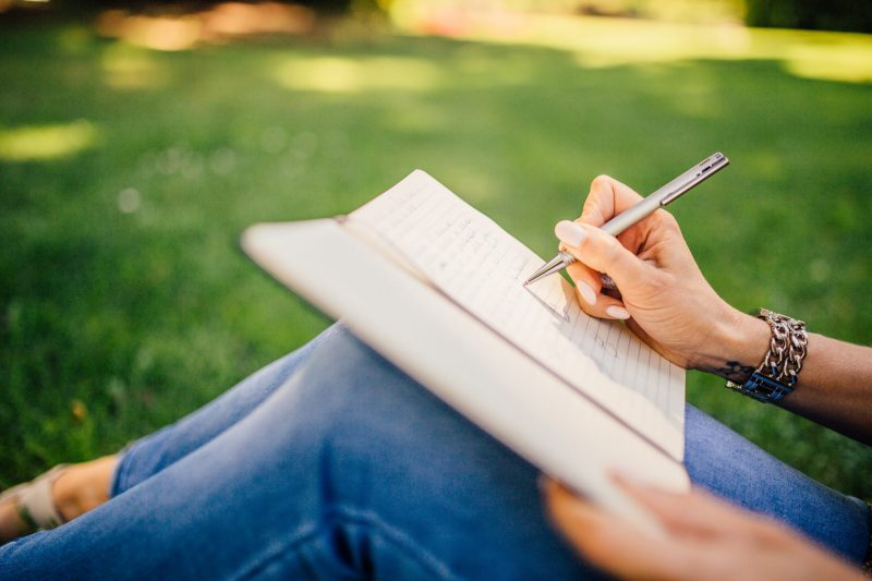 jotting down notes in notebook | get started writing