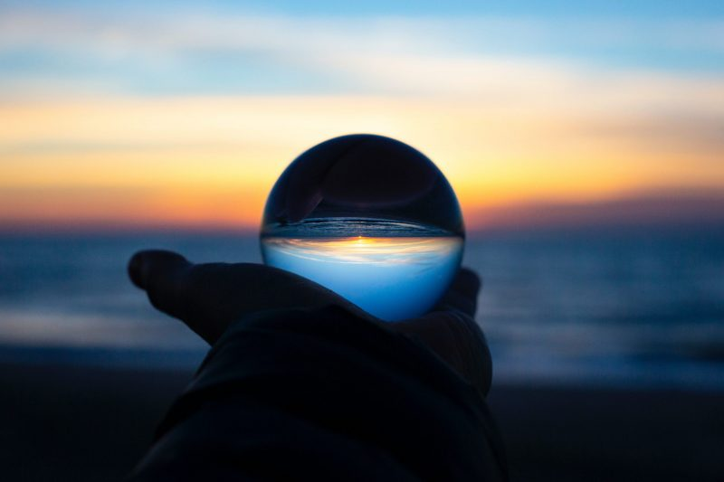 crystal ball on the beach | writing about the pandemic