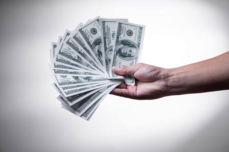 content monetization | money fanned out