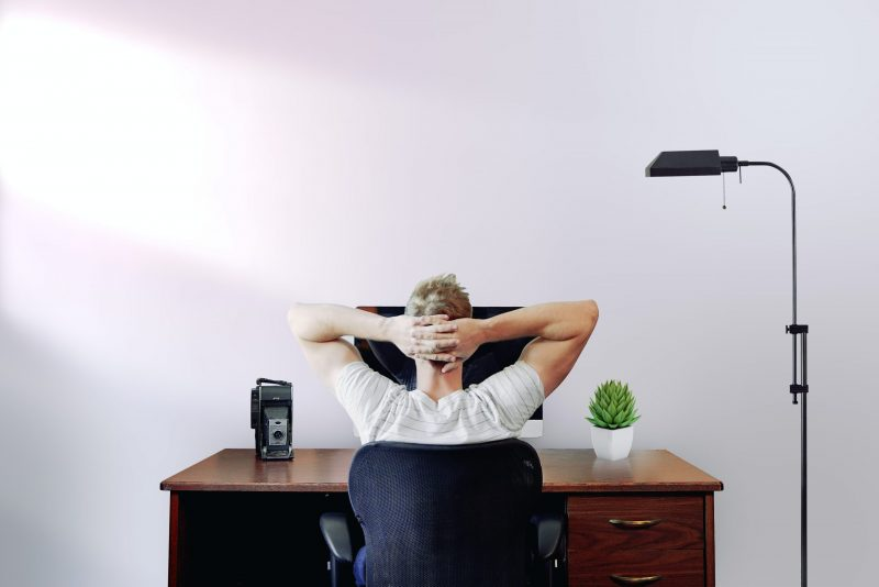 buzzwords | person leaning back in desk chair