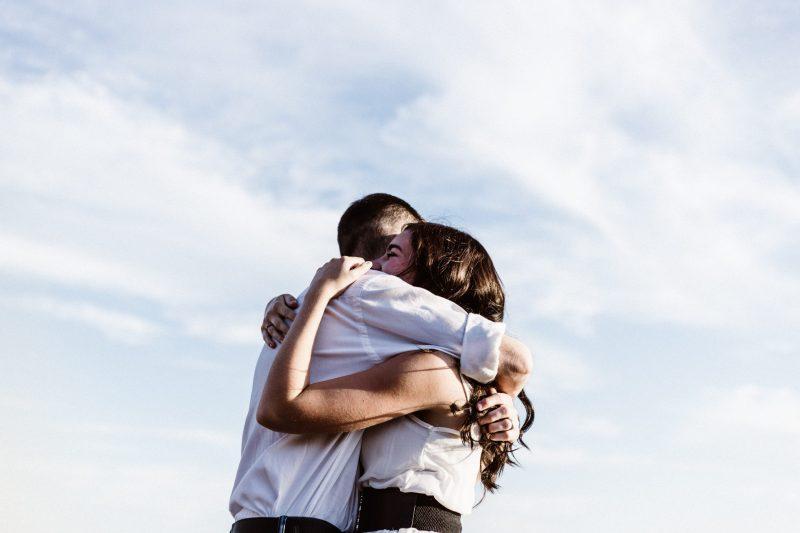 two people hugging | marketing success